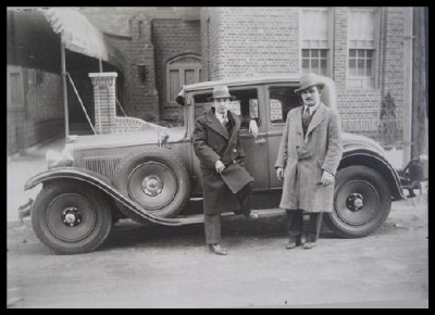 Murray Feldman (left) and his partner in front of one of their holdings. Circa 1930s.